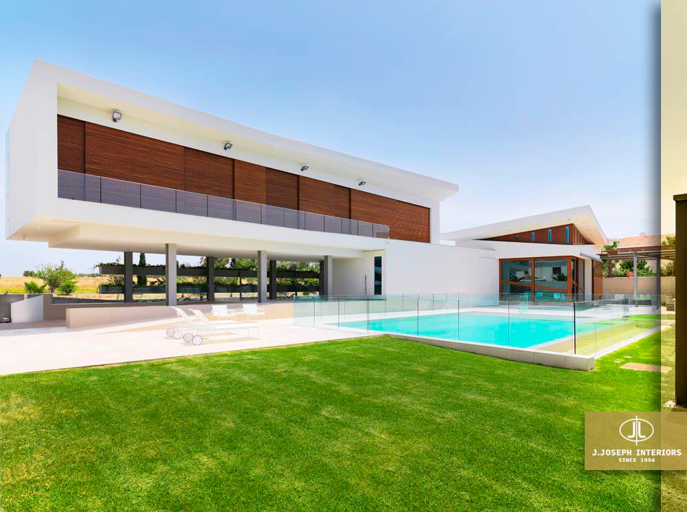 Outdoor house photo with garden and swimming pool.