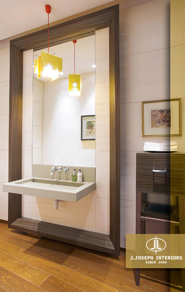 Washbasin with full length mirror and lighting in colors of yellow.