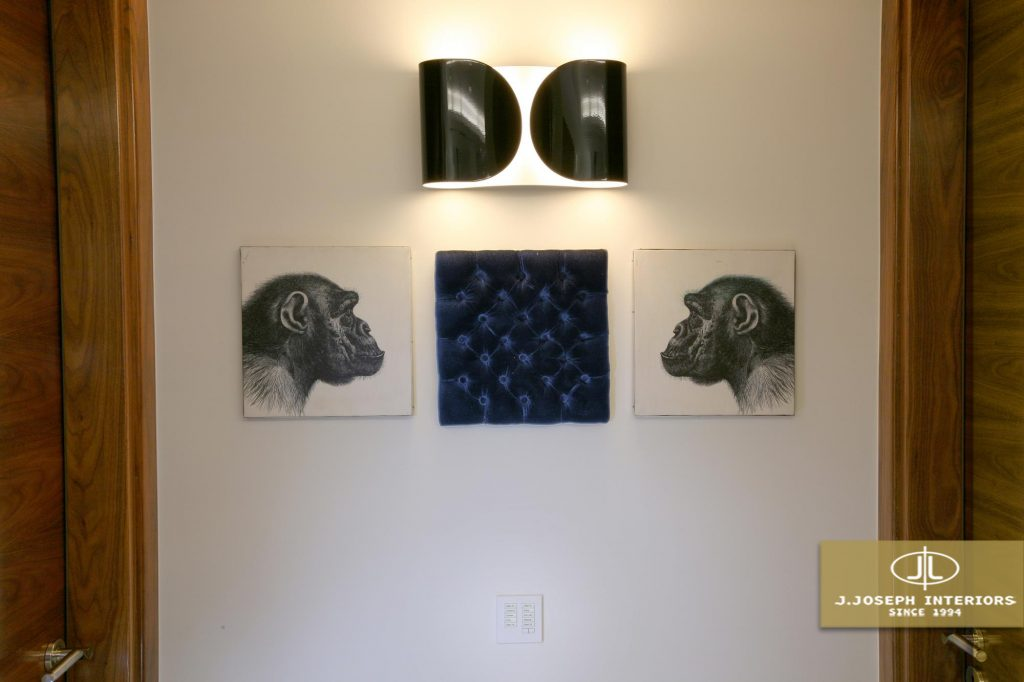 Two paintings on the wall showing two monkeys looking at each other.