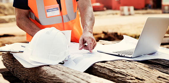 A worker studies the plans of the house.