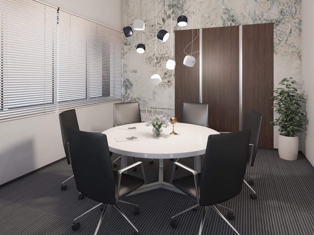 Meeting room, with a small white table and six chairs.