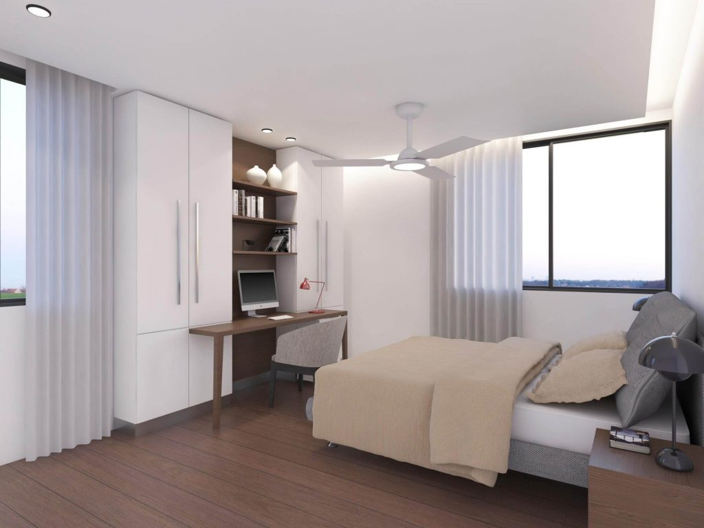 Bedroom, with a small bed, window with view, white cupboard and wooden desk with a mac on it.