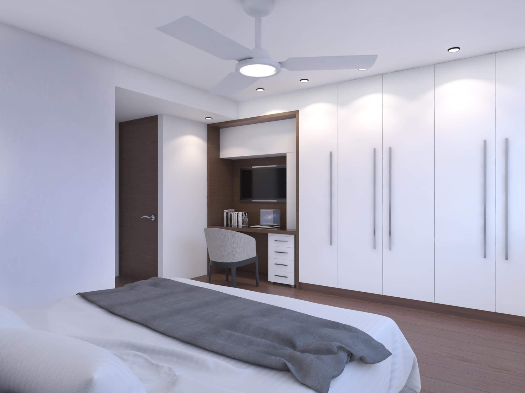 Bedroom with white walls, white cupboard, wooden desk and door.