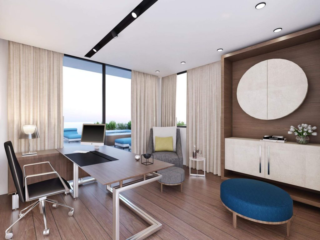 Office room, with black chair, wooden desk, mac and pool view.